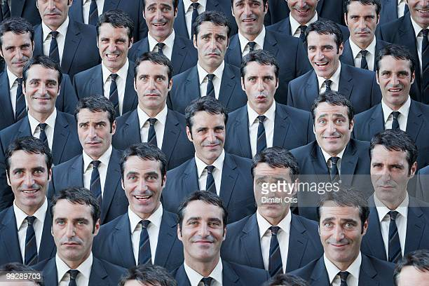 crowd of businessmen with multiple expressions - cloning stock pictures, royalty-free photos & images