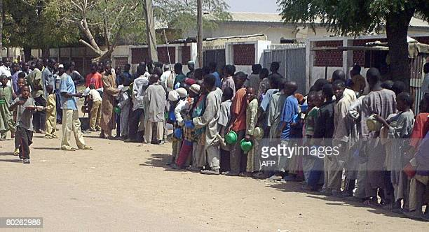 Crowd of child beggars queue for food in a rich neighbourhood of northern Nigeria's Kano city on March 10,2008. Kano has witnessed a radical upsurge...