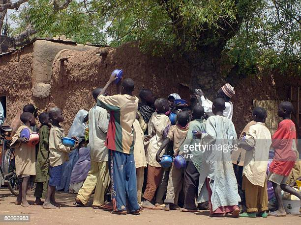 Crowd of child beggars struggle for alms from a man in northern Nigeria's Kano city on March 10,2008. Kano has witnessed a radical upsurge in the...