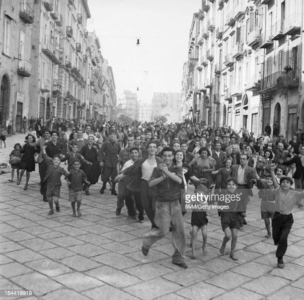 The Campaign In Italy Septemberdecember 1943 The Allied Advance To The Gustav Line Naples September October 1943 A crowd of civilians runs through a...
