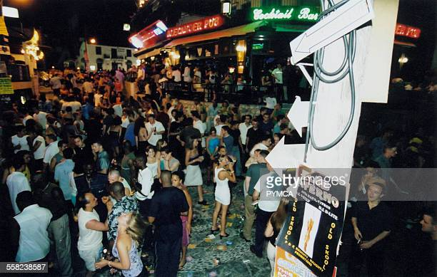 Crowd of clubbers on the main strip in Ayia Napa 1999