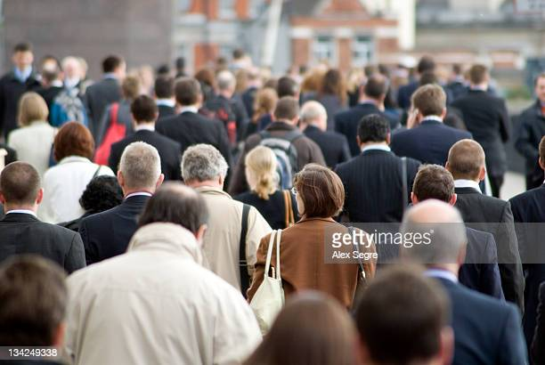 crowd of commuters - crowded stock pictures, royalty-free photos & images