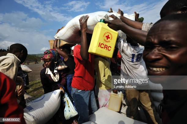 A crowd of Congolese people displaced from recent fighting pick up items during a food distribution in Kibati camp in Goma North Kivu province...
