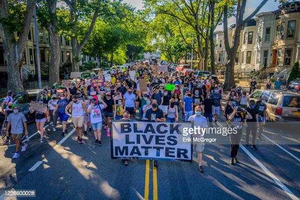 A crowd of counterprotesters marching behind a Black Lives Matter banner at the protest ProNYPD marchers clashed with a big crowd of Black Lives...