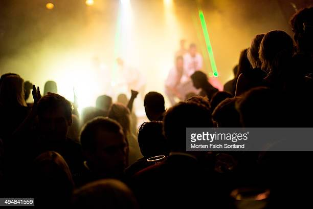 Crowd of current students dancing at a show at the Norwegian School of Economics in Bergen
