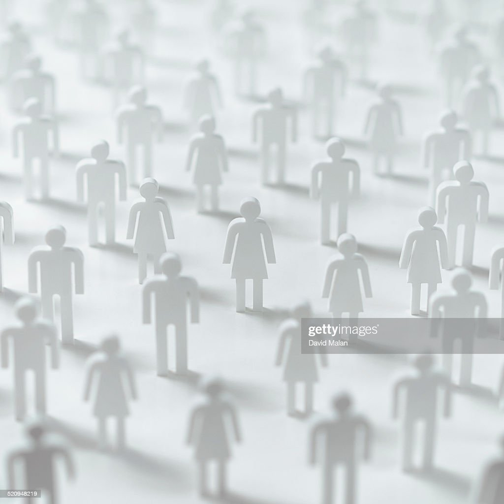 Crowd of cut-out figures, female figure in focus. : Stock Photo