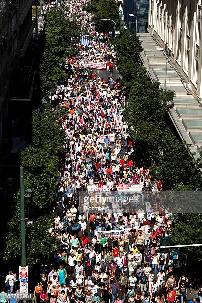 Crowd of demonstrators carry banners during the general strike as they march towards the Greek parliament building on Syntagma square in Athens, on...