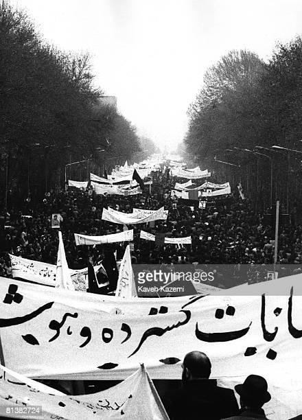 A crowd of demonstrators chanting antiShah slogans make their way through Tehran towards Esfand Square on the Islamic Day of Arbaeen 19th December...