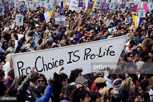 A crowd of demonstrators hold prochoice signs and banners during an abortion rights march in Washington DC The banner reads 'ProChoice IS ProLife'