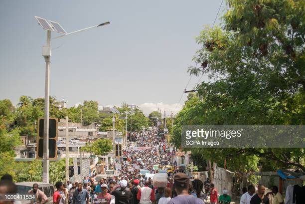 A crowd of demonstrators seen marching from Carrefour Aeroport to Champs de Mars during the protest Protesters gathered to demonstrate against the...