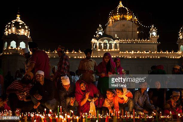 Crowd of devotees celebrating Diwali festival night also Bandi Chhor Divas celebration for the Sikh religion followers at the Gurdwara Dukh Nivaran...