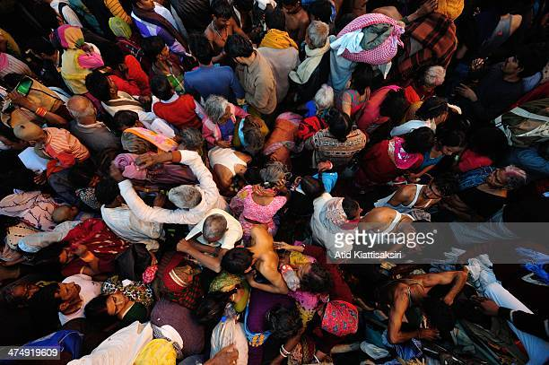 Crowd of devotees on the bank of Sangam, the confluence of Ganges, Yamuna and mythical Saraswati rivers during the Shahi Snan of Mauni Amavasya, the...
