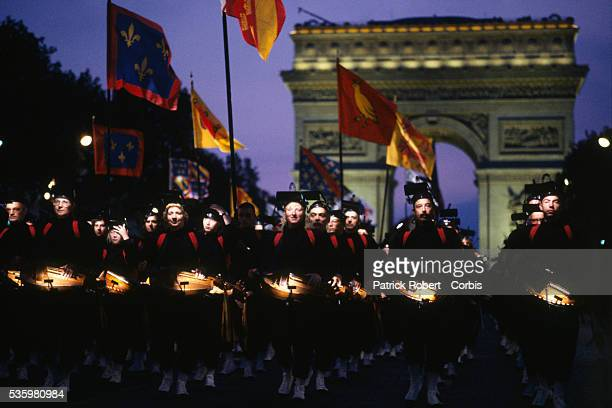 A crowd of drummers parade past the Arc de Triomphe during the 200th anniversary of Bastille Day The event attended by hundreds of thousands of...