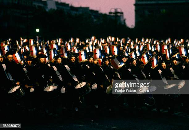 A crowd of drummers participate in a parade celebrating the 200th anniversary of Bastille Day The Paris event attended by hundreds of thousands of...