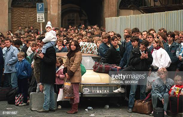 A crowd of EastGerman refugees wait to be transferred 04 November 1989 in Prague to WestGermany via Czechoslovakia after East Germany lifted...