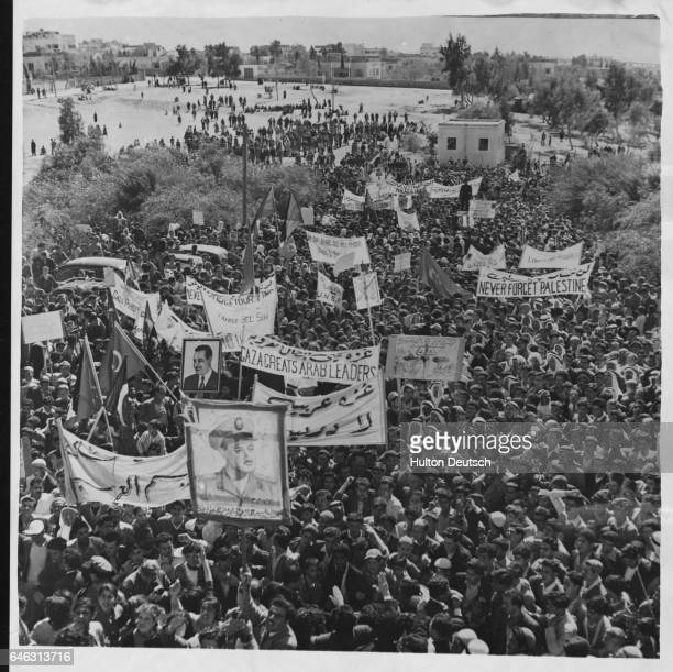 Crowd of Egyptian and Palestinian demonstrators outside the United Nations headquarters at Gaza after Israel's departure from the area. 1957.