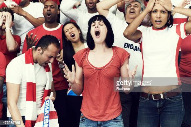 crowd of england fans at sporting event - femme battue photos et images de collection