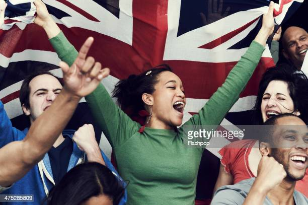crowd of england fans at sporting event - long sleeved stock photos and pictures