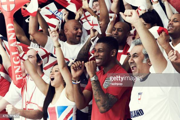 crowd of england fans at sporting event - celebratory event photos et images de collection