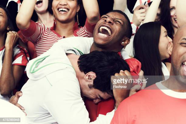 crowd of england fans at sporting event - vreugde stockfoto's en -beelden