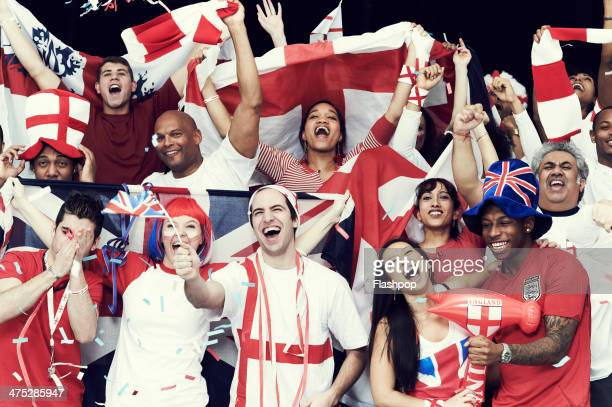 crowd of england fans at sporting event - bandiera inglese foto e immagini stock
