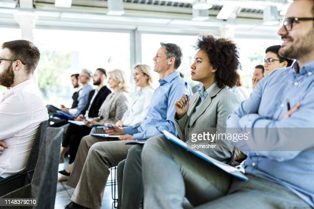 crowd of entrepreneurs paying attention on business seminar in board room. - attending stock pictures, royalty-free photos & images
