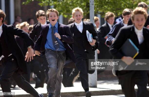Crowd Of Eton Boys Happily Running Out Of School On The Day They Finish Their Examinations At Eton College Boarding School