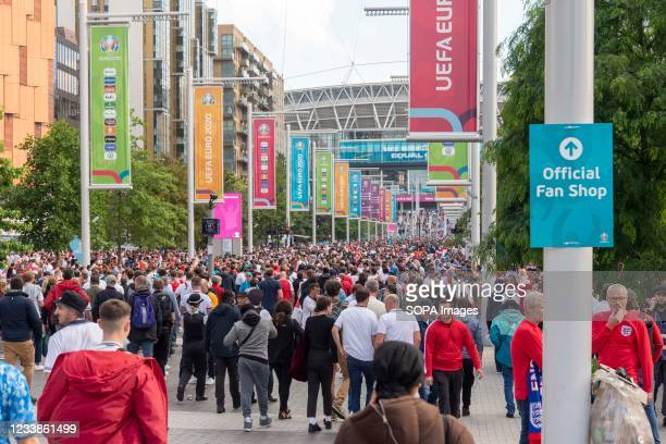 Crowd of fans arriving at Wembley Stadium ahead of the England v Denmark UEFA Euro 2020 semi-final.