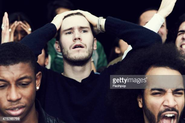 crowd of fans at sporting event - defeat stock photos and pictures