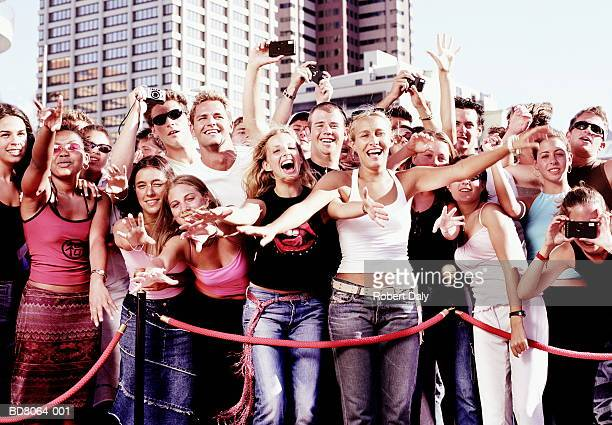 crowd of fans behind rope barrier - fame stock pictures, royalty-free photos & images
