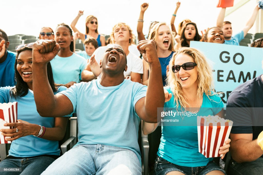 Crowd of fans cheering from stadium bleachers : Stock Photo