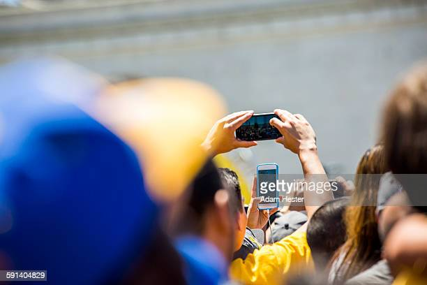 crowd of fans photographing sporting event - sports event stock pictures, royalty-free photos & images