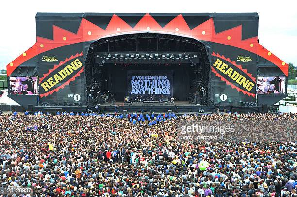 Crowd of festival music fans enjoy the music and atmosphere during Enter Shikari's performance on stage at Reading Festival 2011 at Richfield Avenue...