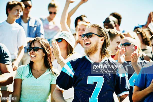 crowd of football fans celebrating after game - american football sport stock pictures, royalty-free photos & images
