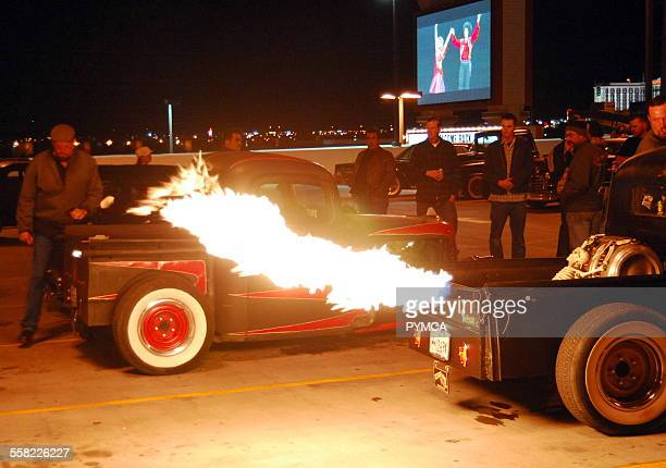 A crowd of guys watching the flames coming out of the exhaust pipe of a customised Hotrod Viva Las Vegas Festival Las Vegas USA 2006