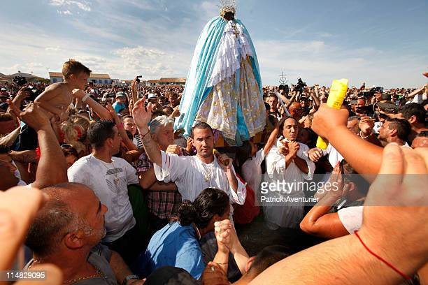 A crowd of gypsies and nongypsy pilgrims accompany the 'craft' with the statue of Sara the Patron Saint of the Gypsies to the sea on May 24 2011 in...