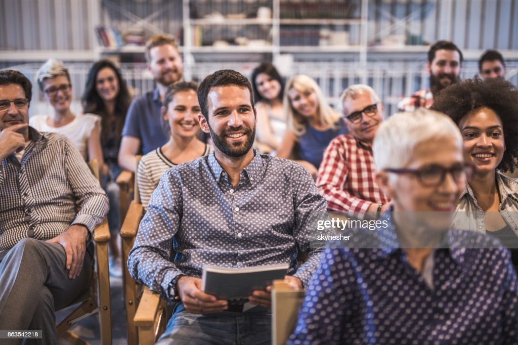 Crowd of happy freelancers attending a professional training class in board room. : Stock Photo