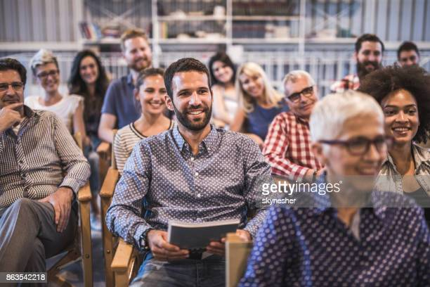 crowd of happy freelancers attending a professional training class in board room. - attending photos stock photos and pictures