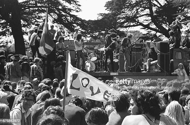 A crowd of hippies listens to a band play at a summer solstice celebration at Golden Gate Park in San Francisco