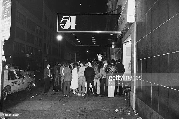 A crowd of hopefuls waits outside the doors of Studio 54 a disco nightclub that was legendary for its selectiveness at the door lax house rules and...