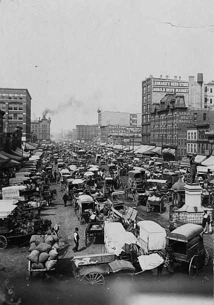 A crowd of horse and carts at the Haymarket in Chicago....