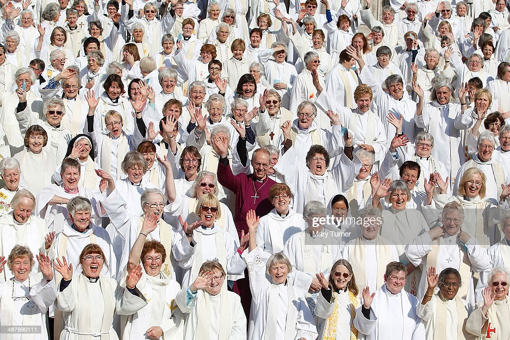 A crowd of hundreds of women priests stand on the steps of St Paul's Cathedral with the Archbishop of Canterbury, Justin Welby, before going inside for a special service to celebrate twenty years since the ordination of women priests on May 3, 2014 in London, England. More than 600 women priests attended the service which comes ahead of a vote in July when the Church of England is expected to pass legislation that will allow the women in the church to be ordained as Bishops.