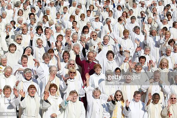 Crowd of hundreds of women priests stand on the steps of St Paul's Cathedral with the Archbishop of Canterbury, Justin Welby, before going inside for...