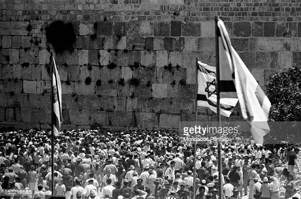 Crowd of Israeli men and women celebrating at the Wailing Wall the conquest of Jerusalem in the Six Days War Jerusalem June 1967