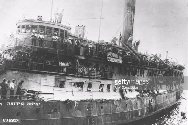 A crowd of Jewish immigrants waiting for the boat to dock on July 18 1947 as they arrive on the 'Exodus 1947' ship to Haifa harbor On November 29 the...