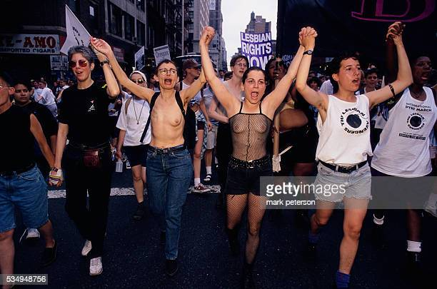 A crowd of lesbian activists march down a Manhattan street during the twentyfifth anniversary celebration of the Stonewall Uprising On June 26 1969...