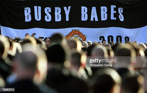 A crowd of Manchester United fans take part in a minute's silence to mark 50 years since the Munich Air Disaster at the club's Old Trafford ground on...