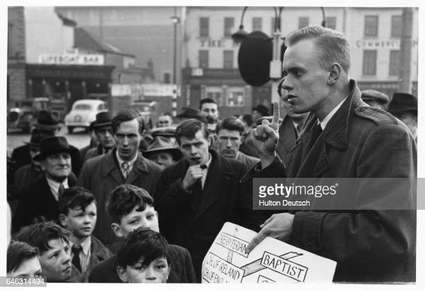 Crowd of men and boys gathers to listen to a religious speaker on a Sunday afternoon in Belfast outside the Customs House.