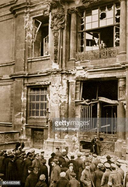 A crowd of men gathered in front of a ruined building Germany c1918c1919 Red Anarchy and Terror Swept over Germany Probably a photograph showing...
