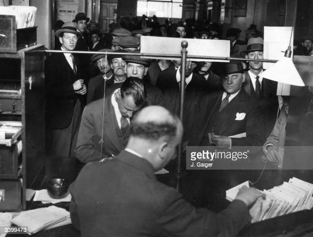 A crowd of men queuing up at the labour exchange at Snow Hill during the Depression